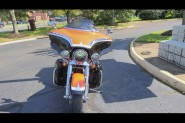 2012 CVO™ Ultra Classic® Electra Glide® FLHTCUSE7 Electric Orange/Black Diamond w/ Big City Graphic