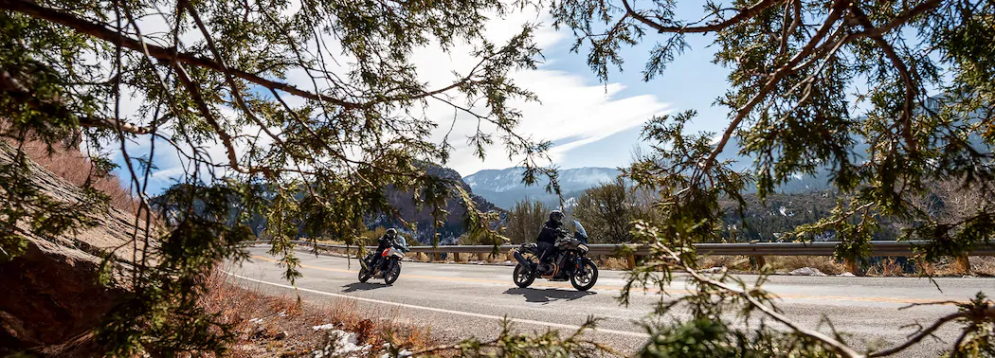 Open road with two drivers on  Harley-Davidson Pan America adventure touring motorcycles