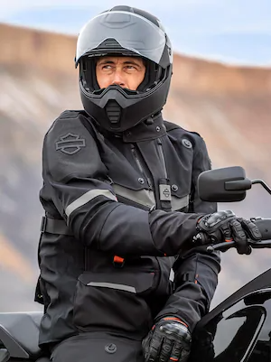 Rider in black Harley gear with a Harley-Davidson Pan America adventure touring motorcycle